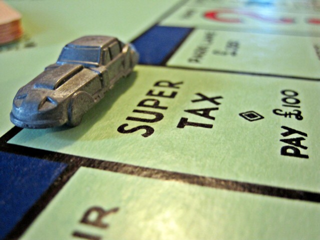Save money on your taxes. super tax square monopoly board